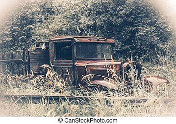 Abandoned Rusty Oldtimer Pickup Truck in the Grass. American...