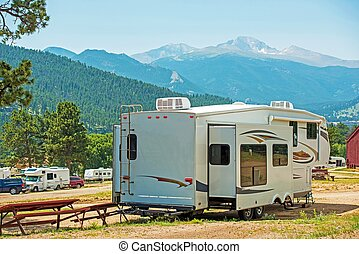 RV Fifth Wheel Camping. Travel Trailer with Extended Sliders...