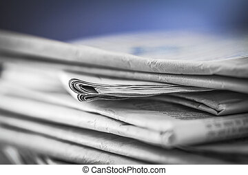 newspaper,document for information - pile of newspapers with...