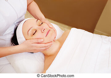 Woman taking facial treatments at beauty spa - Close-up shot...