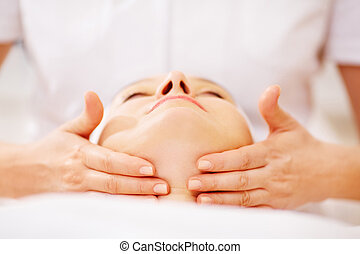 Woman under facial treatment at beauty spa - Close-up shot...