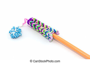 Colorful elastic rainbow loom bands with pencil. - Colorful...