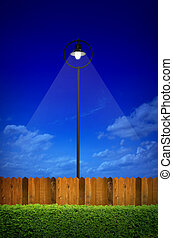 street lighting with shrub and wooden fence