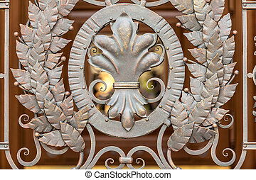 photo of forged metal decoration on gates - Closeup photo of...