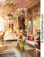 classic french interior with mirrors, lamps and sofas
