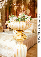 antique porcelain vase with flowers at classic interior -...