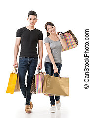 Asian couple shopping, full length portrait isolated on...