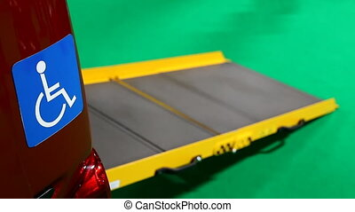 Disabled car ramp Focus change - Close up of blue disabled...