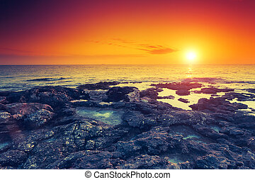 seascape - Amazing red sun over the sea. Volcanic island of...