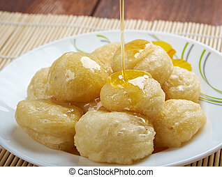 Loukoumades Greek pastry made of deep fried dough soaked in...