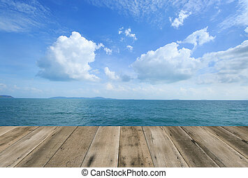 Wood floor with blue sea sky background