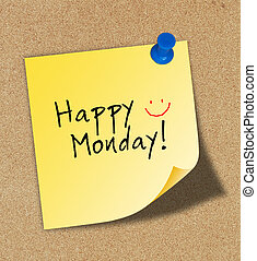Happy monday on paper pinned to a cork notice board.