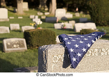 Fallen hero - A US flag folded for a deceased veteran lying...