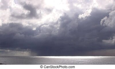 storm clouds above sea time lapse