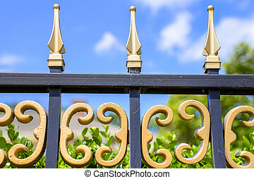 Wrought Iron Fence - Intricate wrought iron fence and blue...