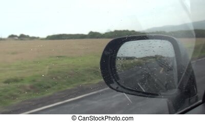 driving car in the rain