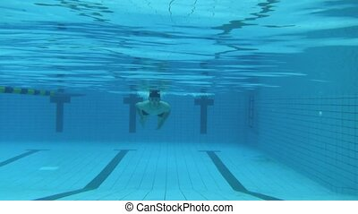 young man swimming under water
