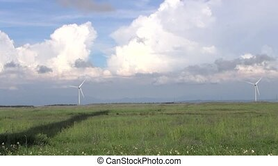 Row of wind turbines generating clean energy in the...