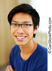 Closeup portrait of a happy asian man