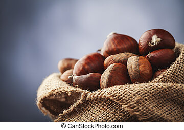 chestnuts in jute - chestnuts, typical autumn winter fruit...