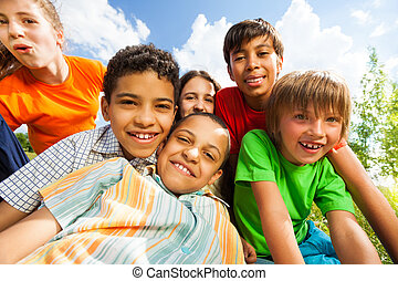 Close up view of smiling kids in a cuddle - Close up view of...