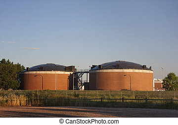 biotowers of water reclamation plant - two brick round...
