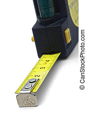 measuring tape - closeup of measuring tape over a white...