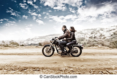 Active couple on the motobike - Active couple riding on the...