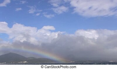 rainbow above the ocean kenting national park taiwan