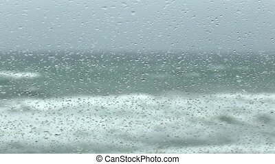 rain on the windshield of car with