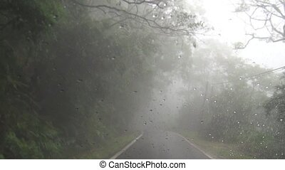 Driving on mountain road in  fog and rain