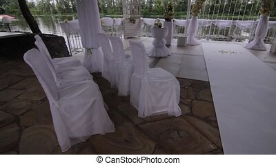 white weddings chairs in the street - panorama of flying...