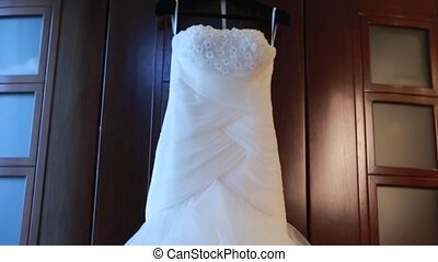 Wedding dress does not peg - a wedding-dress hangs on a peg
