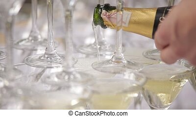 Champaign being pored into glasses. - Champaign. Champaign...