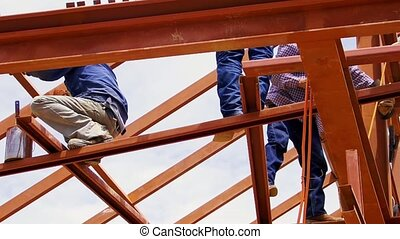 metal structure workers on the beam