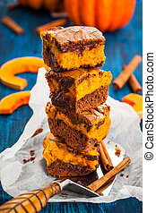 Pumpkin brownies - Pumpkin swirl brownies on blue wooden...