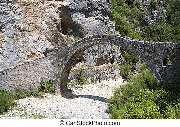Old stone bridge in Greece - Old stone bridge of Kokkori or...