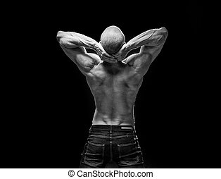 back of muscular man flexing