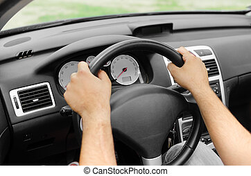 Car driver - Man driving his car Hands holding the wheel