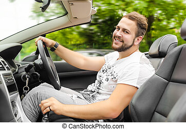 Man driving car - Smiling handsome young man driving...