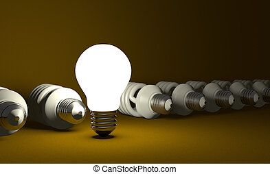 Tungsten light bulb standing among lying spiral ones -...