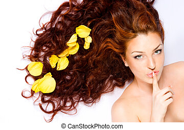 Keep the silense - Close-up beautiful red-haired lady with...