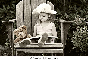 Child reading - Vintage style image of a child reading to...