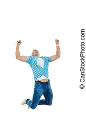 man in blue shirt and jeans jumping in the air with his hands ra