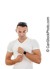 man in white t-shirt pointing a finger at clock to camera -...