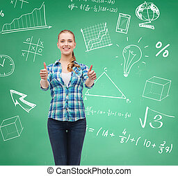 smiling student girl showing thumbs up - education,...