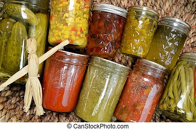 Home Canned Food Variety - Canned food items arranged in a...