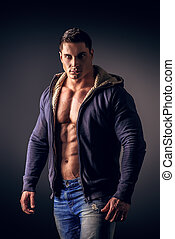 confident - Portrait of a sexy muscular young man posing...