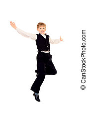 joyful boy - Cheerful ten years schoolboy jumping for joy...