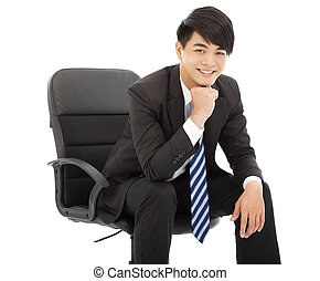 smiling Young businessman sitting on a chair